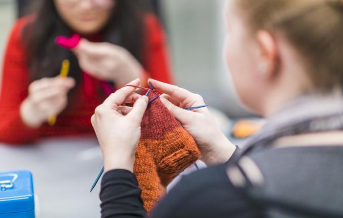 student knitting