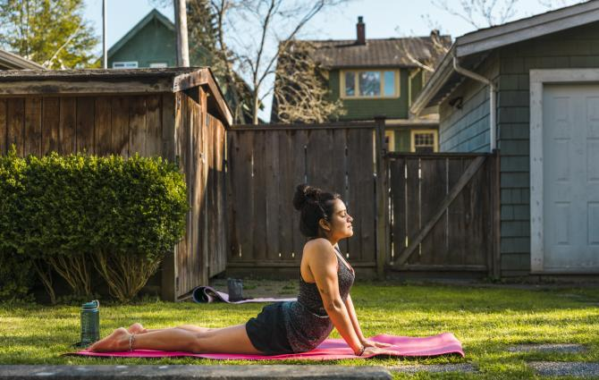 student doing yoga in the backyard