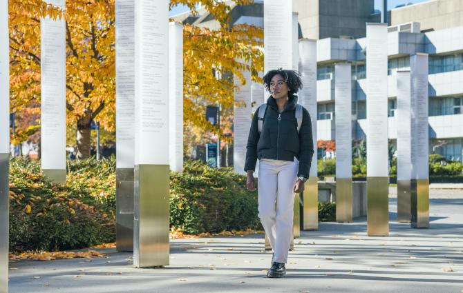 Student walking towards the Robert H. Lee Alumni Centre