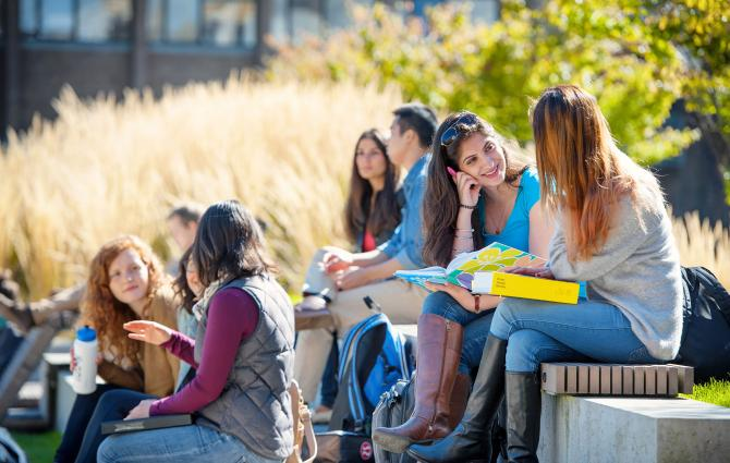 Students sitting and chatting outside at UBC
