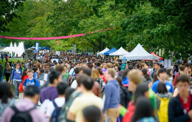Thousands of UBC students walking along Main Mall checking out the Main Event