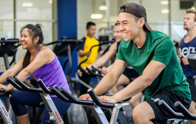 Students on bikes in the gym