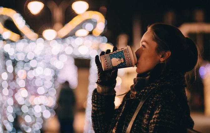 Student in festive setting drinking coffee