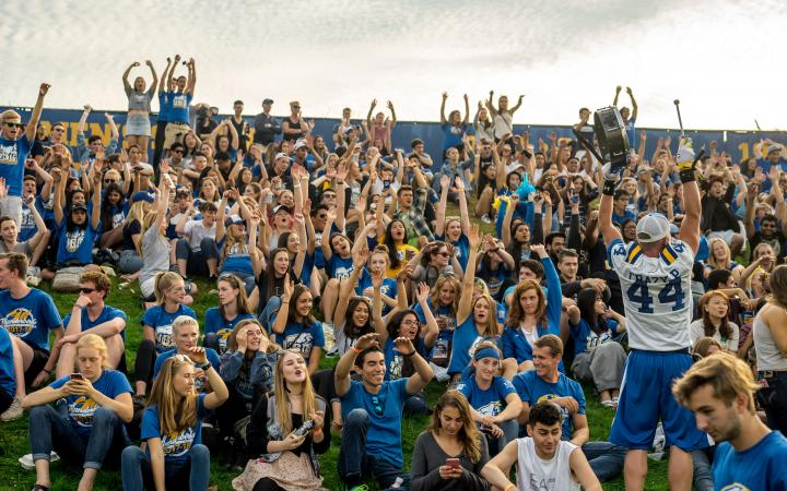 UBC students and alumni cheer on the Thunderbirds football team at Homecoming