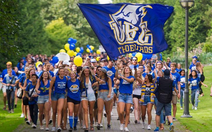 UBC students walk to Thunderbird Stadium during the Great Trek