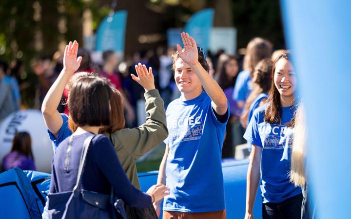 UBC Rec giving high fives to new students at Imagine UBC