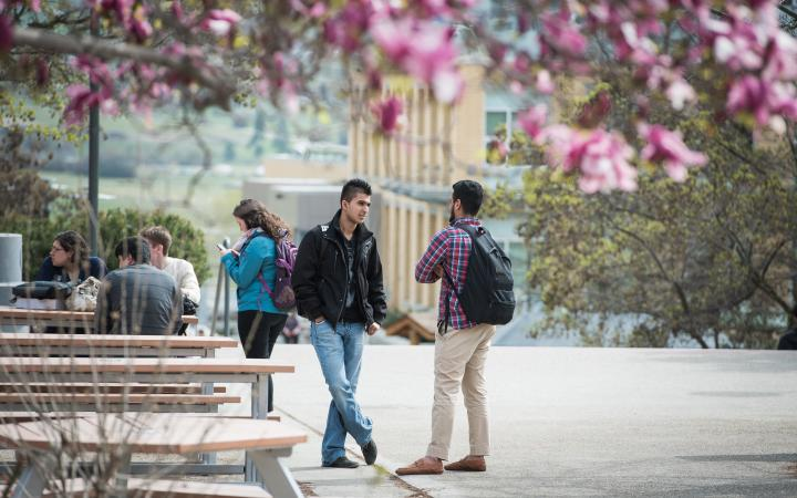 Two students talking outside on the UBCO campus
