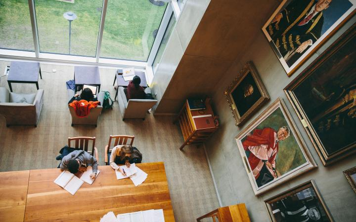 overhead shot of students studying in the ridington room