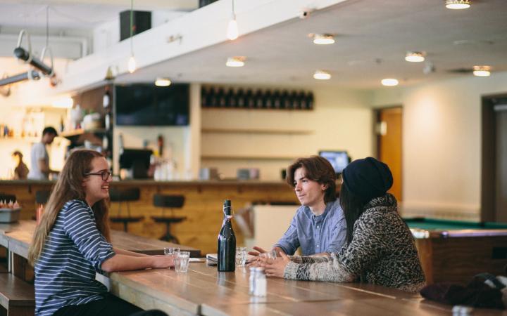three students chatting at koerners