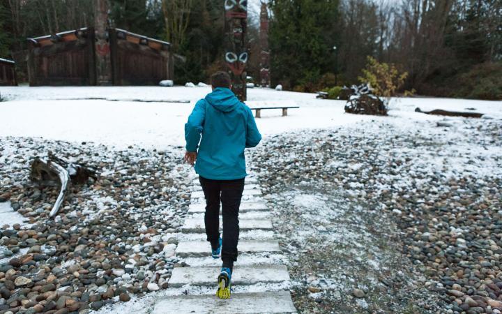 Student running on campus