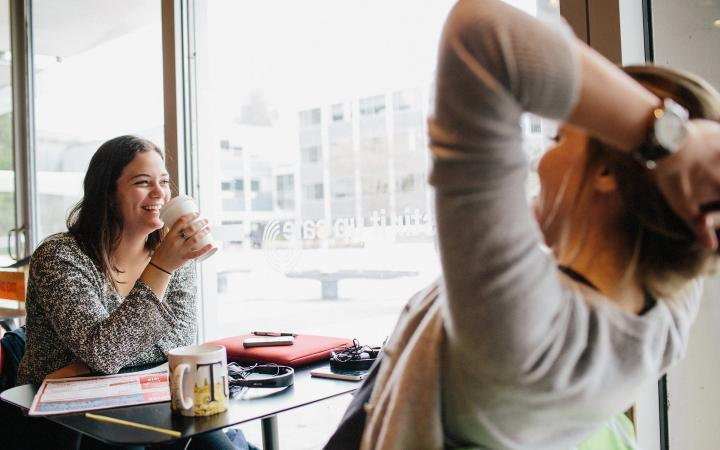 Two students hanging out at a coffee shop