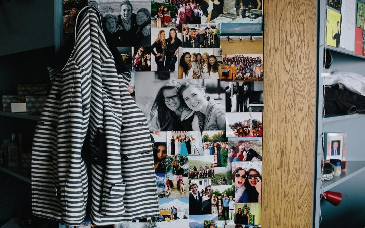 Photos on a wall of a student dorm