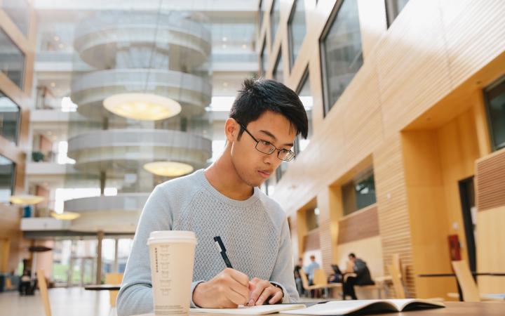 A UBC student studying in the Life Sciences building.