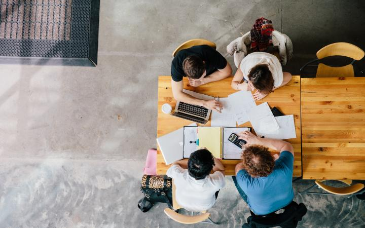 Bird's eye view of four students studying