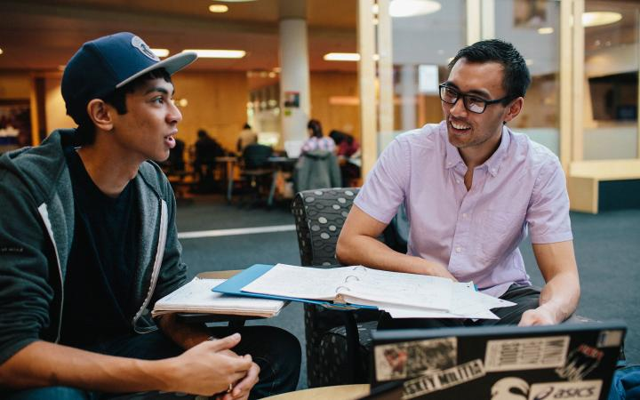A student being coached at a study session
