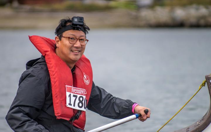 President Ono in a longboat
