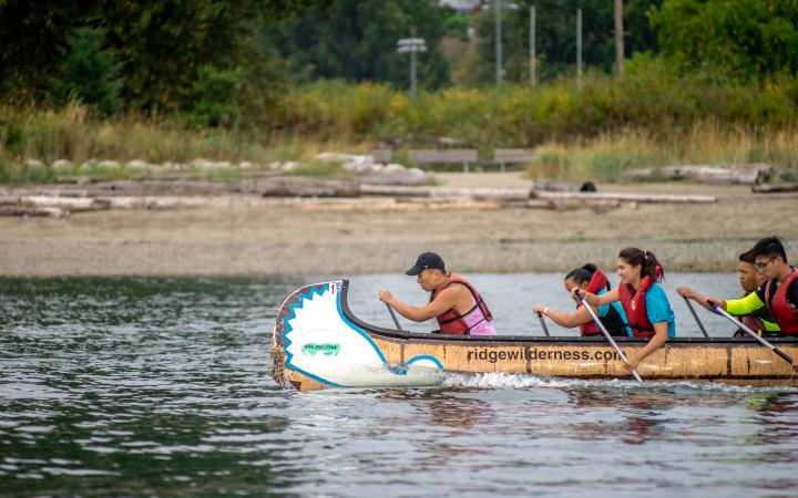 Students racing in a longboat