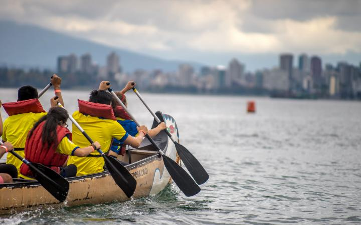 Participants paddling in their canoe at Day of the LongBoat.