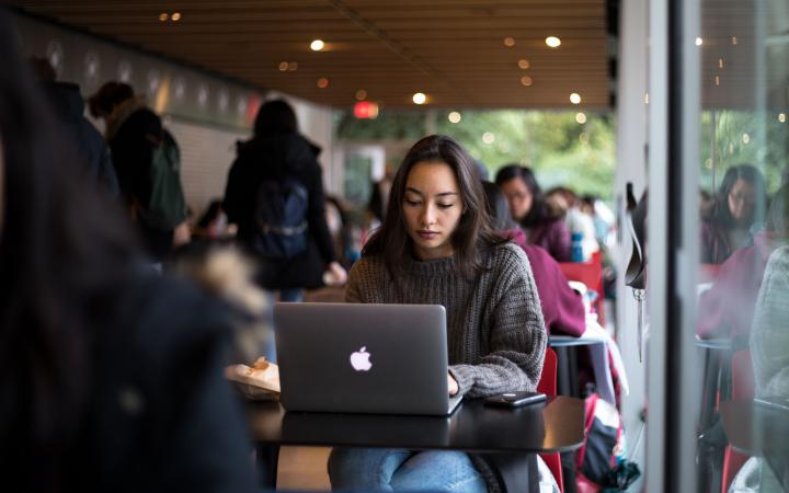 A student watching TV on their laptop in the Buchanan building