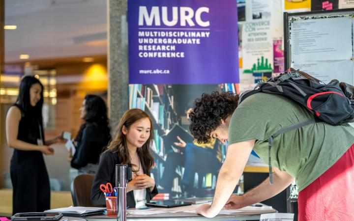 Student signing in at MURC