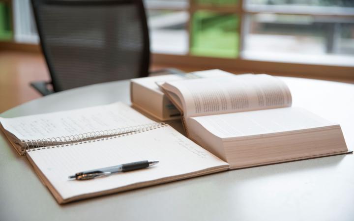 An open notebook and an open textbook