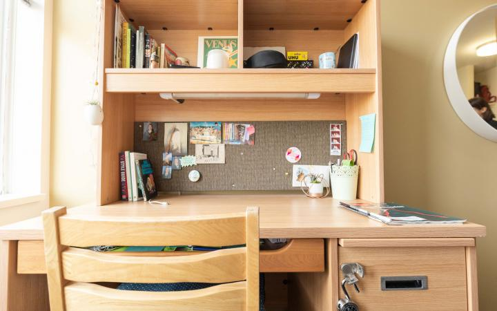 A student's tidy desk in a residence room