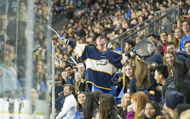 fan standing in crowd