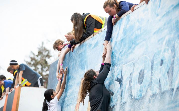 Students climbing the Storm the Wall