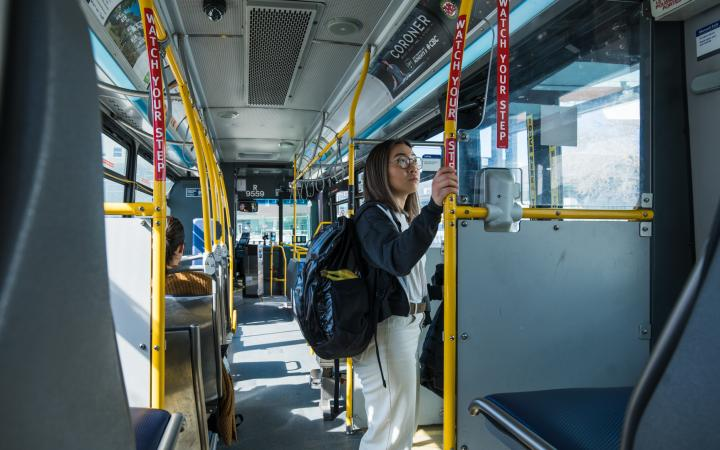Student standing while taking the bus