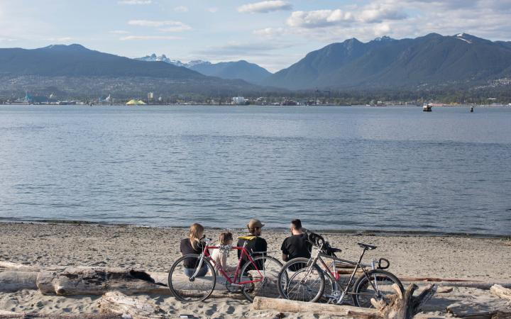 students at the beach with bikes