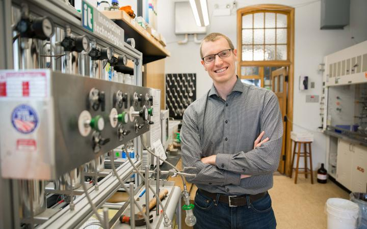 Prof Zachary Hudson standing in his lab at UBC Vancouver