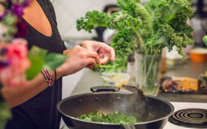 Cooking leafy greens in the kitchen