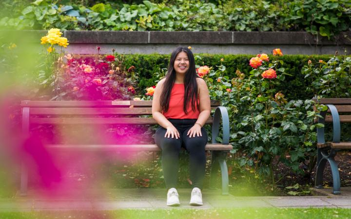 Student sitting in the Rose Garden