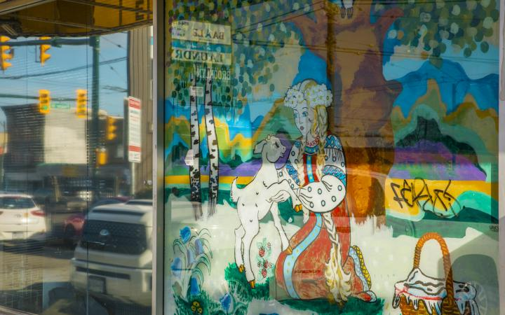 A mural on the side of the Alenka storefront