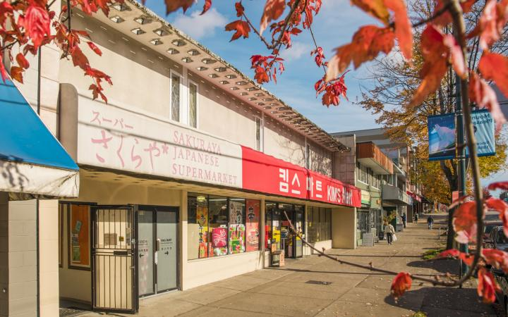 Storefronts of Sakuraya Japanese Supermarket and Korean Kim's Mart