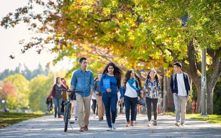 Students walking along campus pathway