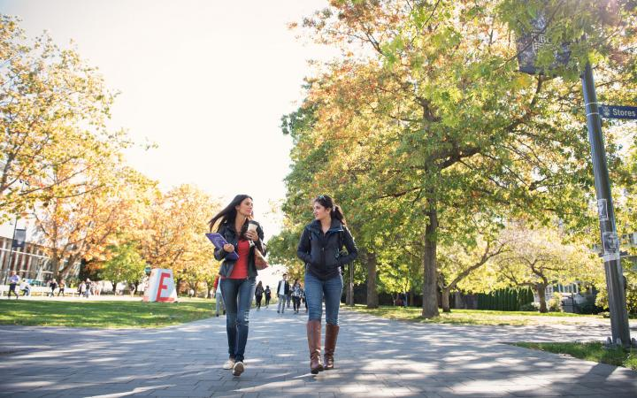 Two students walking on UBC campus
