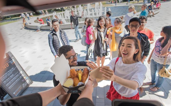 Students ordering lunch from a food truck at UBC Vancouver