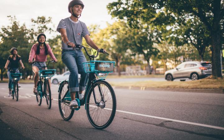 UBC students using HOPR bikes around campus
