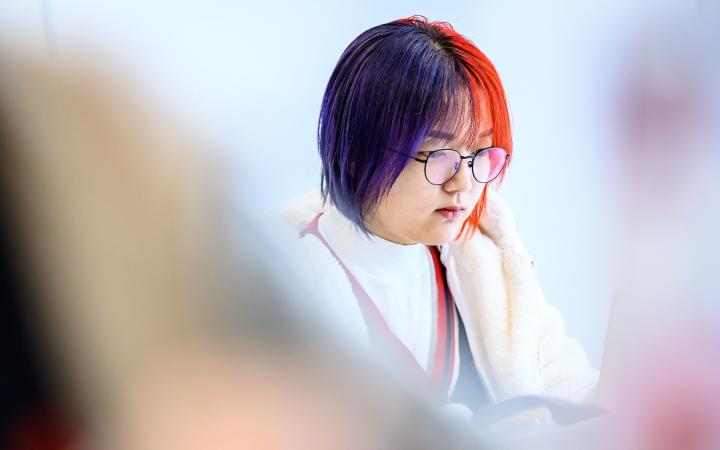 Student looking at a screen
