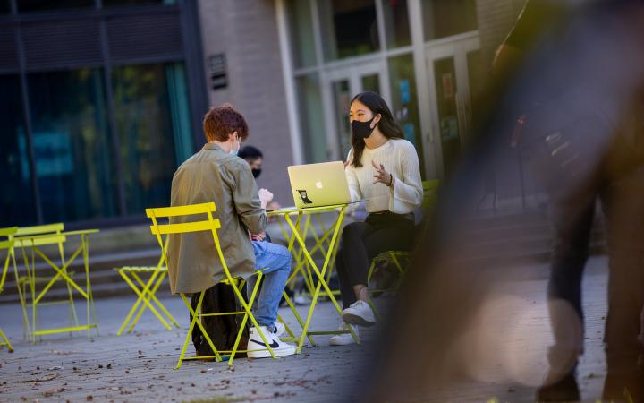 A student conducting an information interview outdoors at UBC