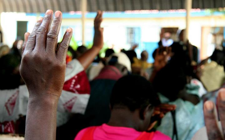 Hand raised in African community meeting