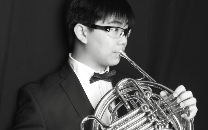 Albert Wu, a UBC student, posing with a french horn