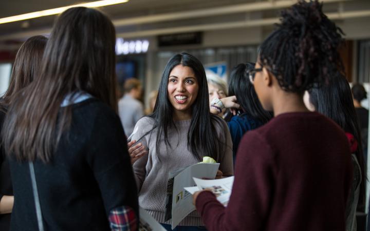 Students talking at SLC