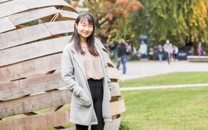 Meg Kuang, a UBC student, outdoors on campus