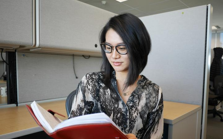 UBC student, Jo, looking at her journal