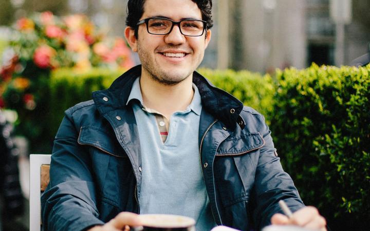 Boy smiling while enjoying coffee