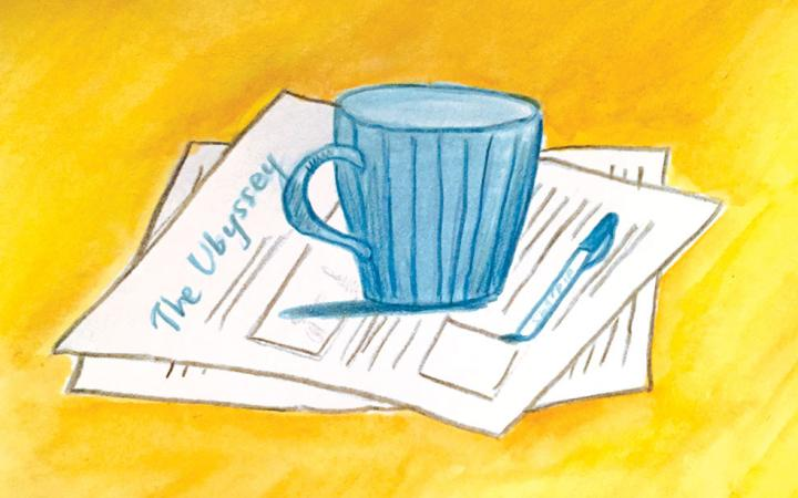 Illustration of a mug sitting atop newspaper