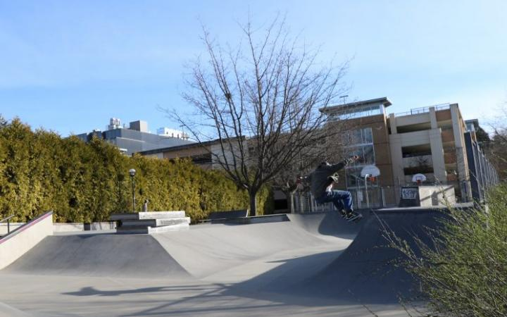 The skate park with the parking garage in the background