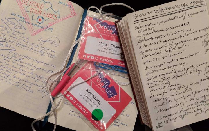 A photograph of two notebooks and conference badges taken at the 2019 SLC